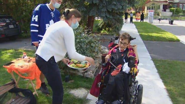 Gabriel Nikolakakis, 9, had no issues trick-or-treating at the Trick Accessibility event Satuday. Many homes set up their Halloween candy stands at the end of the driveway to ensure children with disabilities were able to get the candy they desired without any added barriers. (CBC - image credit)