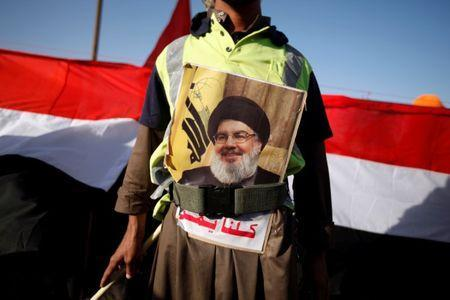 A man sports a poster of Lebanon's Hezbollah leader Sayyed Hassan Nasrallah during a demonstration to commemorate Ashura in Sanaa, Yemen October 12, 2016. REUTERS/Khaled Abdullah