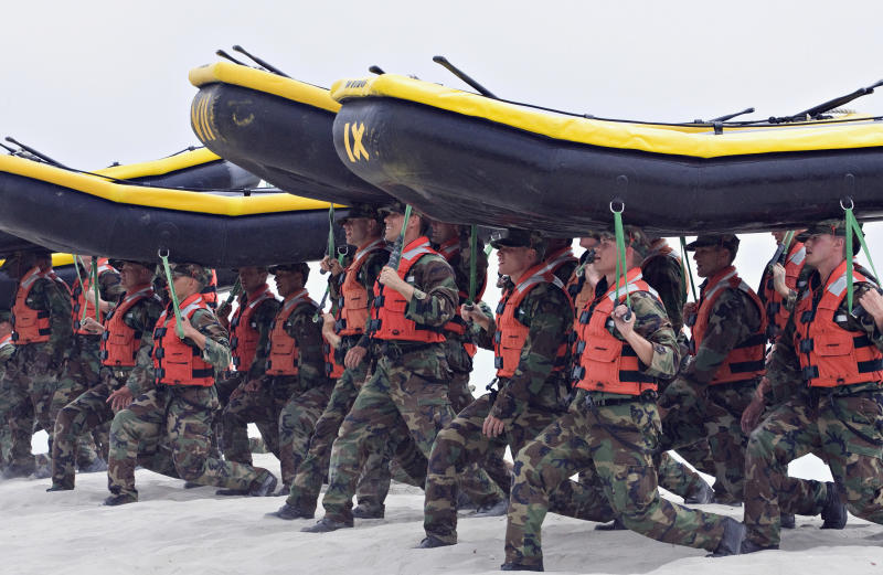 <p> FILE - In this May 14, 2009 file photo, Navy SEAL trainees carry inflatable boats at the Naval Amphibious Base Coronado in Coronado, Calif. The only woman in the Navy SEAL training pipeline has dropped out, a Navy special warfare official confirmed Friday, Aug. 11, 2017. (AP Photo/Denis Poroy, File) </p>