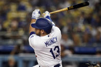 Los Angeles Dodgers' Max Muncy follows through on a double during the first inning of a baseball game against the Arizona Diamondbacks Tuesday, Sept. 14, 2021, in Los Angeles. (AP Photo/Marcio Jose Sanchez)