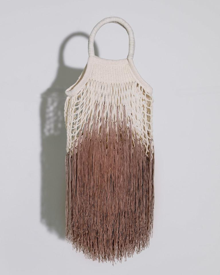 """Started by fashion stylist Nasrin Jean-Baptiste, Petit Kouraj is the latest luxury handbag brand to make waves in Fashion Week street style. Each netted bag is made from over 300 strings of fringe, which take between eight and 12 hours to manufacture by hand. Consider this wearable art. $295, Petit Kouraj. <a href=""""https://www.petitkouraj.com/shop/p8v8rzyfkgbccus20uygarhe9rw57j"""">Get it now!</a>"""