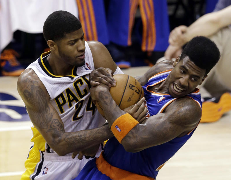 Indiana Pacers forward Paul George, left, and New York Knicks forward Iman Shumpert get tied up during the second half of Game 3 of the Eastern Conference semifinal NBA basketball playoff series in Indianapolis, Saturday, May 11, 2013.  (AP Photo/Michael Conroy)