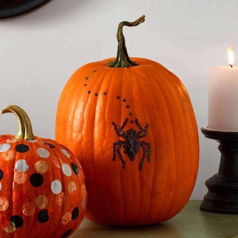 """<p>Few creatures are as Halloween-y as spiders with all of their eight-legged creepiness. Use tweezers and the adhesive to secure the sequins to the pumpkin. </p><p> <a class=""""link rapid-noclick-resp"""" href=""""https://www.amazon.com/SEQUINS-sequins-embroidery-applique-embellishment/dp/B001OO1VU4?tag=syn-yahoo-20&ascsubtag=%5Bartid%7C10070.g.331%5Bsrc%7Cyahoo-us"""" rel=""""nofollow noopener"""" target=""""_blank"""" data-ylk=""""slk:SHOP BLACK SEQUINS"""">SHOP BLACK SEQUINS</a> </p>"""
