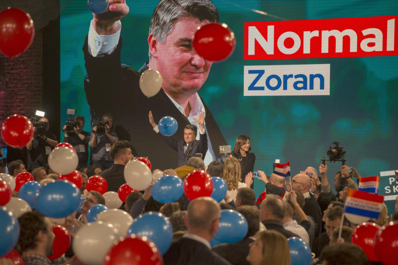 Presidential candidate Zoran Milanovic greets his supporters in Zagreb, Croatia, Sunday, Dec. 22, 2019. The race for Croatia's next president is heading to a runoff vote. A preliminary count from an election held Sunday showed neither the incumbent nor any of the 10 other candidates won the office outright. With nearly all ballots counted, liberal opposition candidate Zoran Milanovic was leading the race with nearly 30% support. (AP Photo/Darko Bandic)