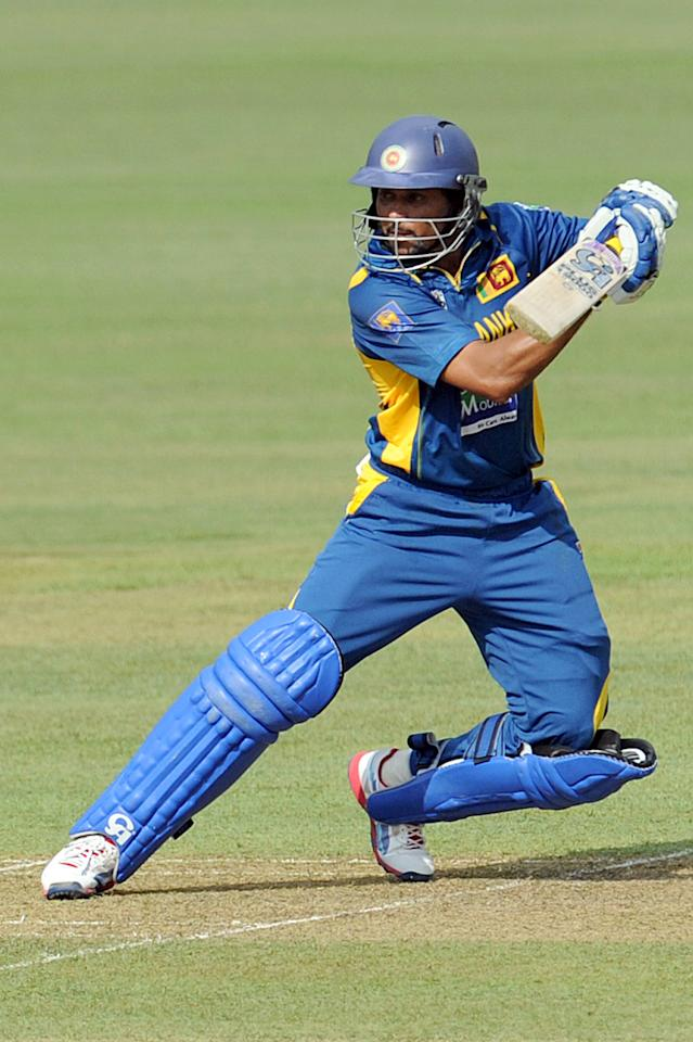 Sri Lankan cricketer Tillakaratne Dilshan plays a shot during the third and final one-day international (ODI) match between Sri Lanka and Bangladesh at The  Pallekele International Cricket Stadium in Pallekele on March 28, 2013. AFP PHOTO/ Ishara S. KODIKARA        (Photo credit should read Ishara S.KODIKARA/AFP/Getty Images)