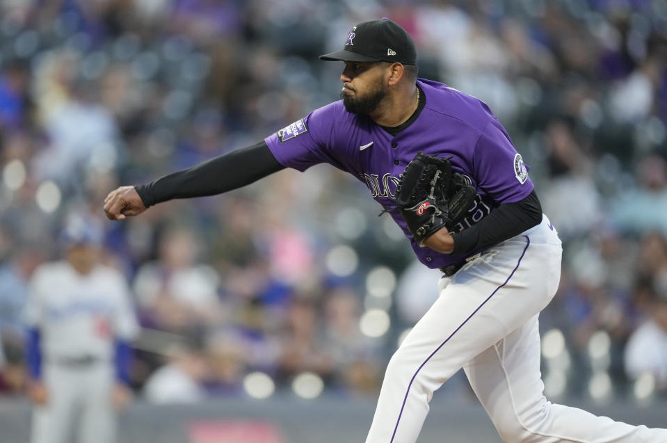 Colorado Rockies starting pitcher German Marquez works against the Los Angeles Dodgers in the first inning of a baseball game Wednesday, Sept. 22, 2021, in Denver. (AP Photo/David Zalubowski)
