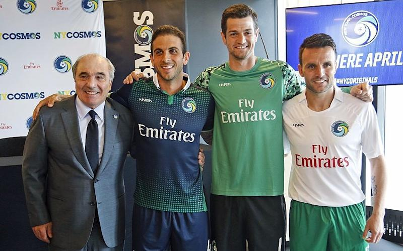 New start: New York Cosmos owner Rocco Commisso (left) poses with players Carlos Mendes, Jimmy Maurer and Ayoze Perez during a news conference in the Brooklyn this week - AP