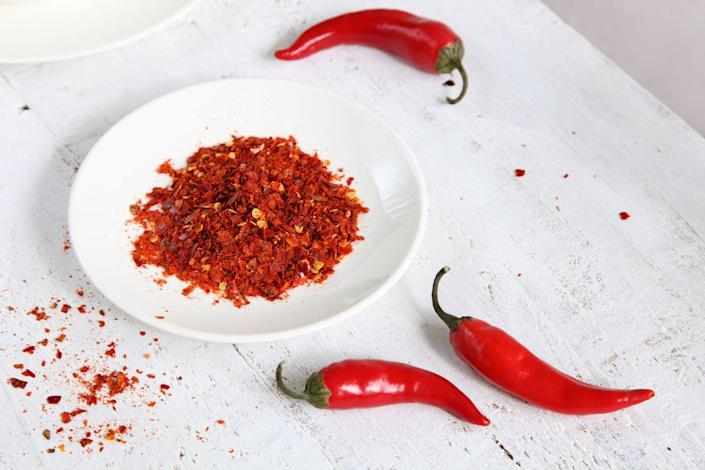 """<p>""""In addition to adding a kick of flavor to your favorite foods, cayenne pepper may also help increase weight loss as well,"""" says Dr. Axe. """"This is thanks to the presence of a compound called capsaicin, which helps enhance feelings of fullness, reduce cravings and speed up your metabolism."""" You can add it to smoothies, mix it in soups, or use it to boost the flavor profile of vegetables like those in this <a href=""""https://www.prevention.com/food-nutrition/recipes/a22666681/spiced-grilled-eggplant-recipe/"""" rel=""""nofollow noopener"""" target=""""_blank"""" data-ylk=""""slk:Spiced Grilled Eggplant with Fresh Tomato Salad"""" class=""""link rapid-noclick-resp"""">Spiced Grilled Eggplant with Fresh Tomato Salad</a>.</p>"""