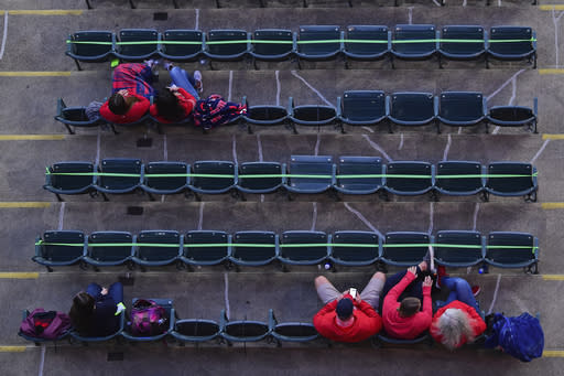 Guests and family members of the traveling party sit in the stands before the start of Game 1 of an American League wild-card baseball series between the New York Yankees and Cleveland Indians, Tuesday, Sept. 29, 2020, in Cleveland. (AP Photo/David Dermer)