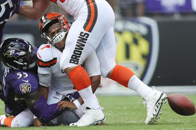 <p>Outside linebacker Terrell Suggs #55 of the Baltimore Ravens tackles quarterback DeShone Kizer #7 of the Cleveland Browns in the first quarter at M&T Bank Stadium on September 17, 2017 in Baltimore, Maryland. (Photo by Patrick Smith/Getty Images) </p>