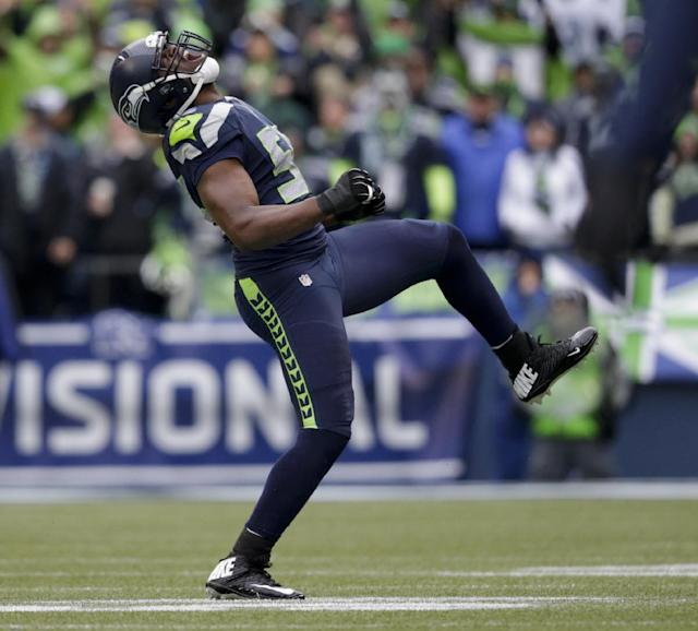 Seattle Seahawks defensive end Cliff Avril celebrates a sack during the third quarter of an NFC divisional playoff NFL football game against the New Orleans Saints in Seattle, Saturday, Jan. 11, 2014. (AP Photo/John Froschauer)