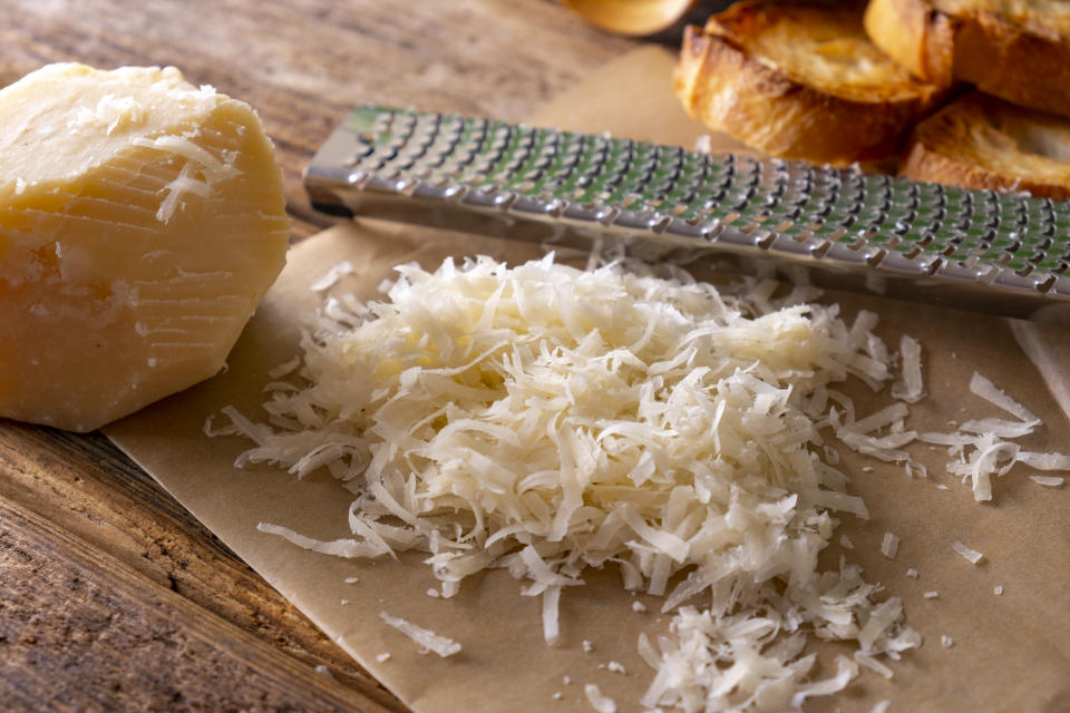 Parmesan cheese grated with hand grater