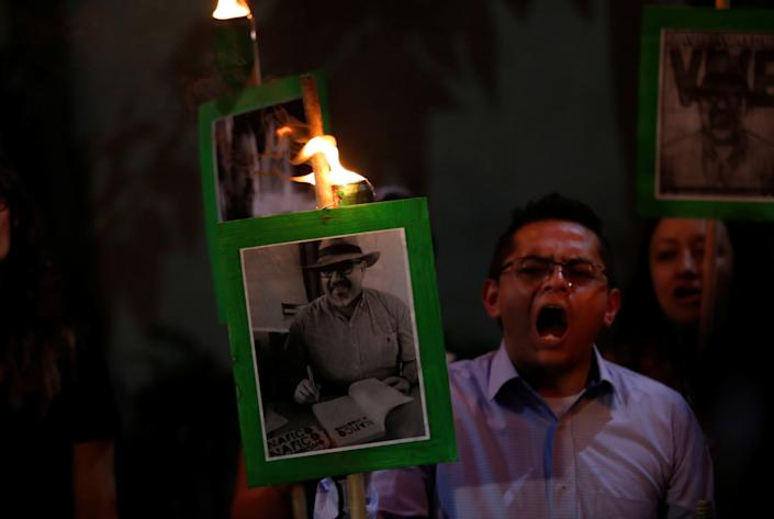 Demonstrators in Mexico City earlier this year held up pictures of journalist Javier Valdez Cardenas to call attention to his killing and the slayings of other journalists in Mexico. (Photo: Henry Romero / Reuters)