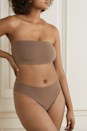 """Prepare to be wowed with how supportive this bandeau is. Available in 13 colors (nudes and bright neons included), Skims' strapless bralette is something you can wear fuss-free, thanks to a super-smoothing fabric that molds and stretches to your body without ever slipping down. $28, Net-a-Porter. <a href=""""https://www.net-a-porter.com/en-us/shop/product/skims/lingerie/strapless-bras/fits-everybody-bandeau-bra-oxide/46353151654530005"""" rel=""""nofollow noopener"""" target=""""_blank"""" data-ylk=""""slk:Get it now!"""" class=""""link rapid-noclick-resp"""">Get it now!</a>"""