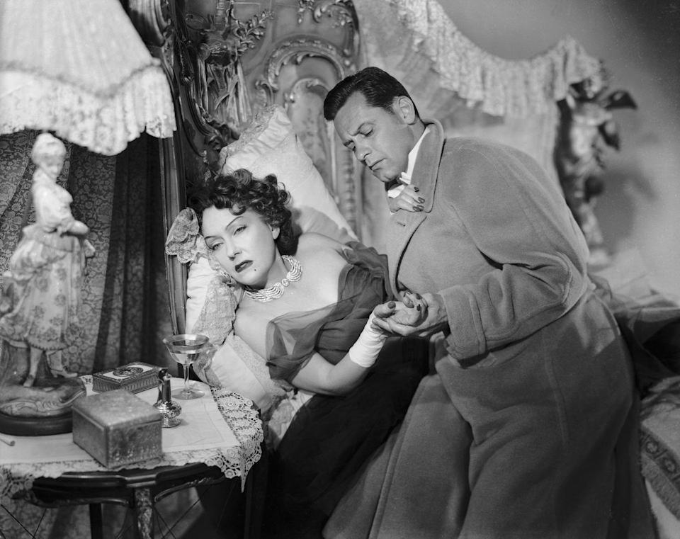 """<p>Gloria Swanson's diamond wing choker was worn as a statement piece during a harrowing and iconic scene in <em>Sunset Boulevard.</em> The dazzling necklace had an <a href=""""https://recycledmoviecostumes.tumblr.com/post/88206592551/this-absolutely-beautiful-winged-diamond"""" rel=""""nofollow noopener"""" target=""""_blank"""" data-ylk=""""slk:onscreen history"""" class=""""link rapid-noclick-resp"""">onscreen history</a> both before and after the film. First, appearing in <em>The Lady Eve </em>on actress Barbara Stanwyck in 1941, and later gracing the neck of Zsa Zsa Gabor in the 1966 film, <em>Picture Mommy Dead</em><em>.</em></p>"""
