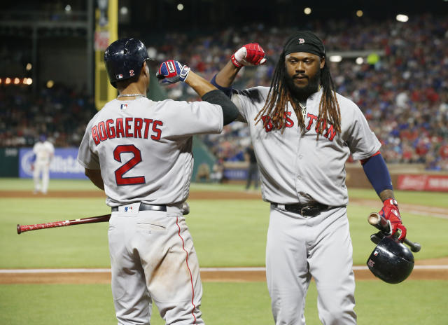 Boston Red Sox's Xander Bogaerts (2) congratulates Hanley Ramirez, right, after Ramirez drove in the winning run against the Texas Rangers during the ninth inning of a baseball game Saturday, May 5, 2018, in Arlington, Texas. (AP Photo/Michael Ainsworth)