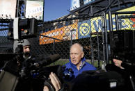 New York Mets general manager Sandy Alderson speaks to the media in the outfield of Citi Field in New York, Tuesday, Nov. 18, 2014. The Mets are moving their fences in at Citi Field for the second time. (AP Photo/Seth Wenig)