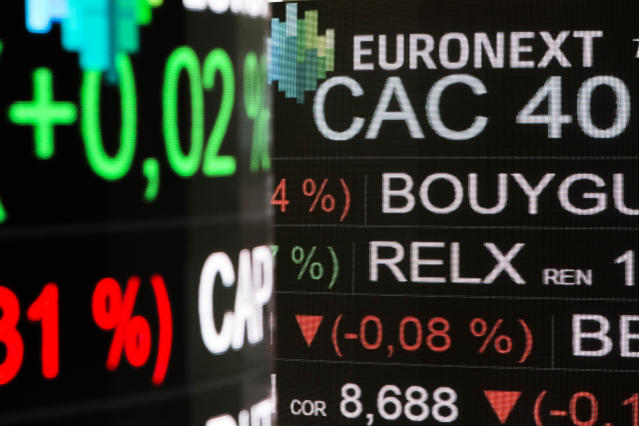 Boards show indexes at the Euronext headquarters in Paris, where stocks gained on Wednesday. Photo: AP Photo/Kamil Zihnioglu