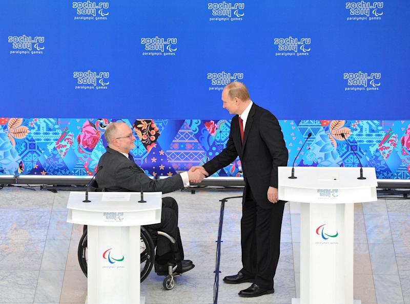 Russian President Vladimir Putin, right, shakes hands with President of the International Paralympic Committee Philip Craven during a meeting with heads of national paralympic committees in Sochi, Russia, Thursday, March 13, 2014. (AP Photo/RIA Novosti Kremlin, Mikhail Klimentyev, Presidential Press Service)