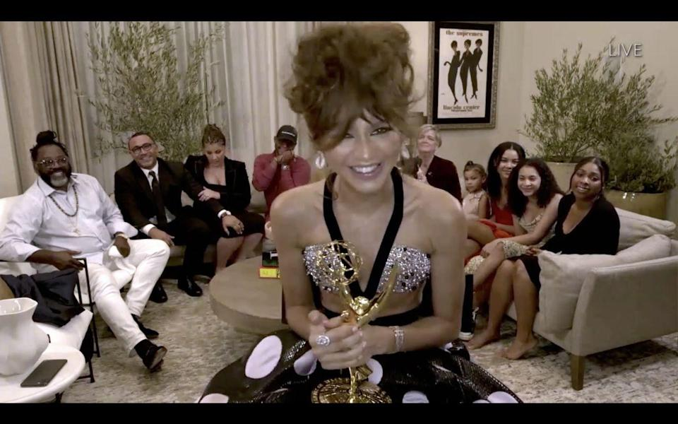 """<p>At the 2020 Emmy Awards, Zendaya wore this dazzling Giorgio Armani Prive gown to accept her award and made history as the youngest woman to win Best Actress for a Drama series. A <a href=""""https://www.instagram.com/p/CFaHbBZgKmx/"""" rel=""""nofollow noopener"""" target=""""_blank"""" data-ylk=""""slk:less blurry, jaw-dropping pic here"""" class=""""link rapid-noclick-resp"""">less blurry, jaw-dropping pic here</a> for reference. </p>"""