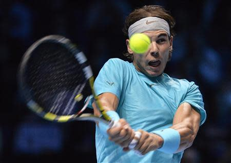 Rafael Nadal of Spain plays a shot to Novak Djokovic of Serbia during their men's final singles tennis match at the ATP World Tour Finals at the O2 Arena in London November 11, 2013. REUTERS/Toby Melville