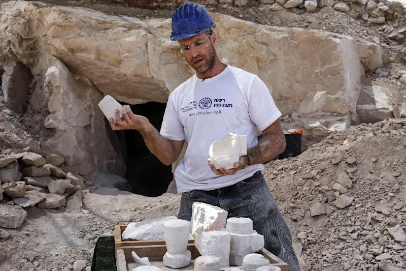 Archaeologist Yonatan Adler displays chalkstone mugs and cores on August 10, 2017, two months after they were discovered near the Israeli village of Reina, close to Cana