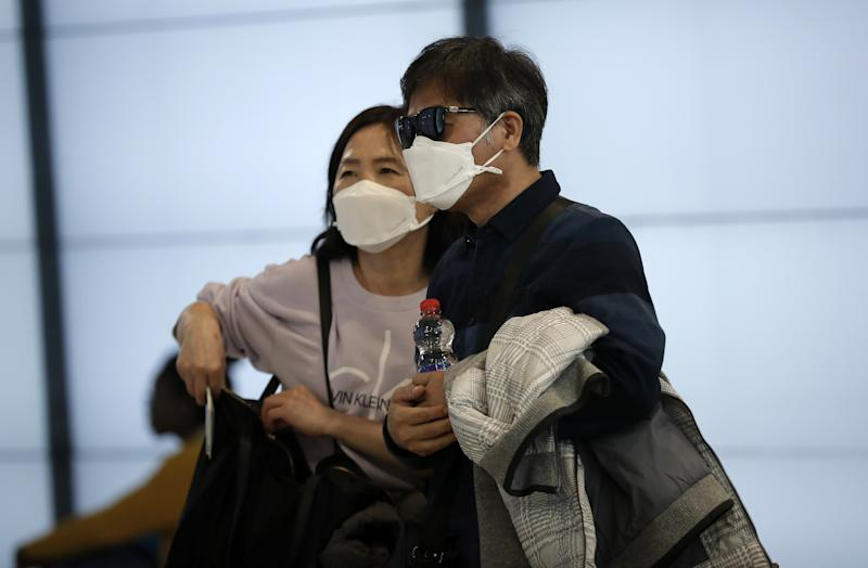 MADRID, SPAIN - MARCH 12: Travellers wear face masks as a precaution against coronavirus at Barajas Airport in Madrid, Spain on March 12, 2020. (Photo by Burak Akbulut/Anadolu Agency via Getty Images)