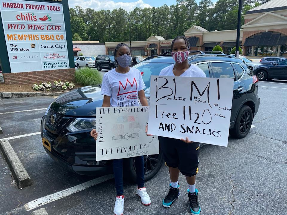 Natasha McKend and Tanaesja Milligan joined the protest and brought water and snacks. (Yahoo)