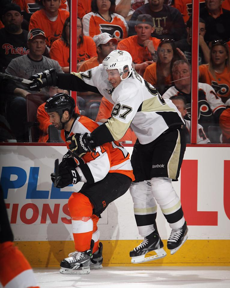 PHILADELPHIA, PA - APRIL 15: Sidney Crosby #87 of the Pittsburgh Penguins tries to get past Maxime Talbot #27 of the Philadelphia Flyers in Game Three of the Eastern Conference Quarterfinals during the 2012 NHL Stanley Cup Playoffs at Wells Fargo Center on April 15, 2012 in Philadelphia, Pennsylvania. The Flyers defeated the Penguins 8-4. (Photo by Bruce Bennett/Getty Images)
