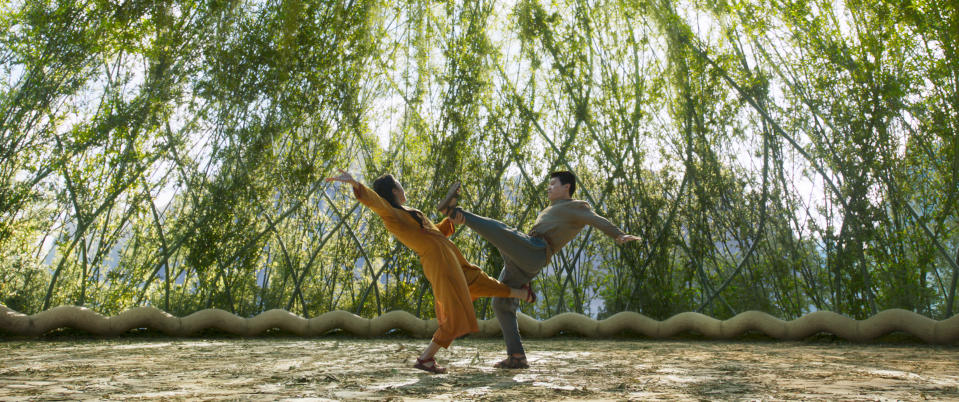 """This image released by Marvel Studios shows Michelle Yeoh and Simu Liu, right, in a scene from """"Shang-Chi and the Legend of the Ten Rings."""" (Marvel Studios via AP)"""