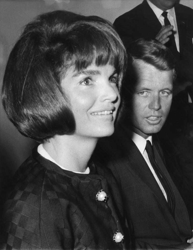 "FILE - In this May 25, 1964 file photo, Mrs. Jacqueline Kennedy, wife of the late president, John F. Kennedy, talks to newsmen during a preview tour of the exhibit of the late President Kennedy's mementoes, in New York. At her side is U.S. Attorney General Robert Kennedy, brother of John F. Kennedy. Janis Hirsch's note, among some 800,000 sent to Mrs. Kennedy in the two months after President John F. Kennedy's Nov. 22, 1963, killing in Dallas, is featured along with about 20 others in ""Letters to Jackie: Remembering President Kennedy,"" airing 9 p.m. EST Sunday, Nov. 17, 2013, on TLC. (AP Photo, File)"