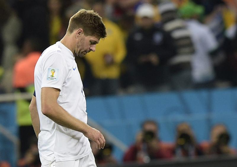 England's Steven Gerrard walks off the pitch after losing the World Cup match against Uruguay on June 19, 2014