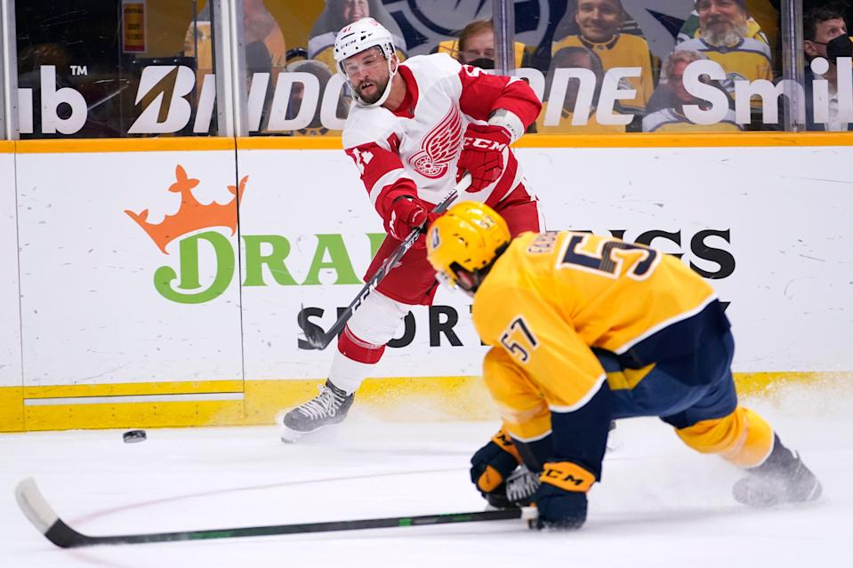 Detroit Red Wings center Luke Glendening (41) passes the puck past Nashville Predators defenseman Dante Fabbro (57) in the first period Saturday, Feb. 13, 2021, in Nashville, Tenn.