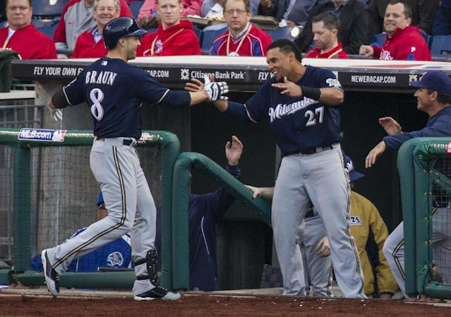 Milwaukee Brewers' Ryan Braun, left, celebrates his home run with Carlos Gomez, right, during the fourth inning of an MLB National League baseball game against the Philadelphia Phillies, Tuesday, April 8, 2014, in Philadelphia. (AP Photo/Chris Szagola)