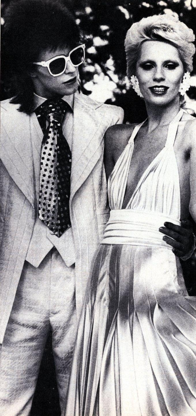 """<p>David Bowie met Angelina Barnett in 1969 when Barnett was 19. They <a href=""""http://www.mirror.co.uk/3am/celebrity-news/david-bowies-first-wife-angie-7155221"""" rel=""""nofollow noopener"""" target=""""_blank"""" data-ylk=""""slk:were married"""" class=""""link rapid-noclick-resp"""">were married</a> on March 20, 1970 and had one son together, Duncan. Angie was responsible for helping Bowie conceptualize his outfits and image during his """"Ziggy Stardust"""" phase. They divorced in 1980 after nine years of marriage. <br></p>"""