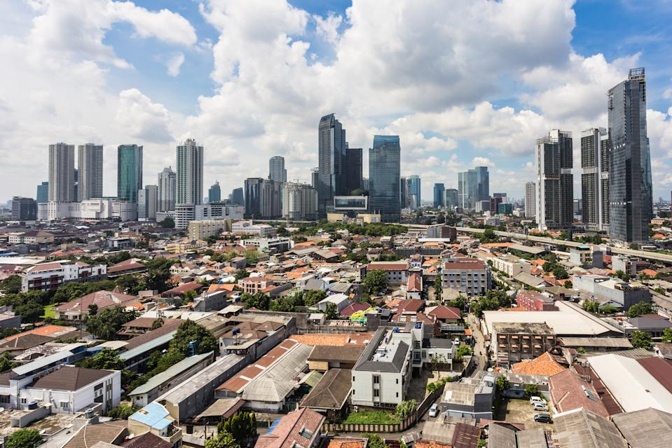 Jakarta skyline around the business district with many office tower and luxury condominium contrasts with the residential areas that are in the heart of Indonesia capital city.