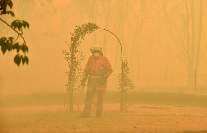 A fireman fights a bushfire to protect a property in Balmoral, 150 kilometres southwest of Sydney.