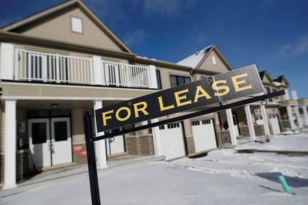 """A """"For lease"""" sign stands in front of a row of houses in a newly build subdivision in East Gwillimbury"""