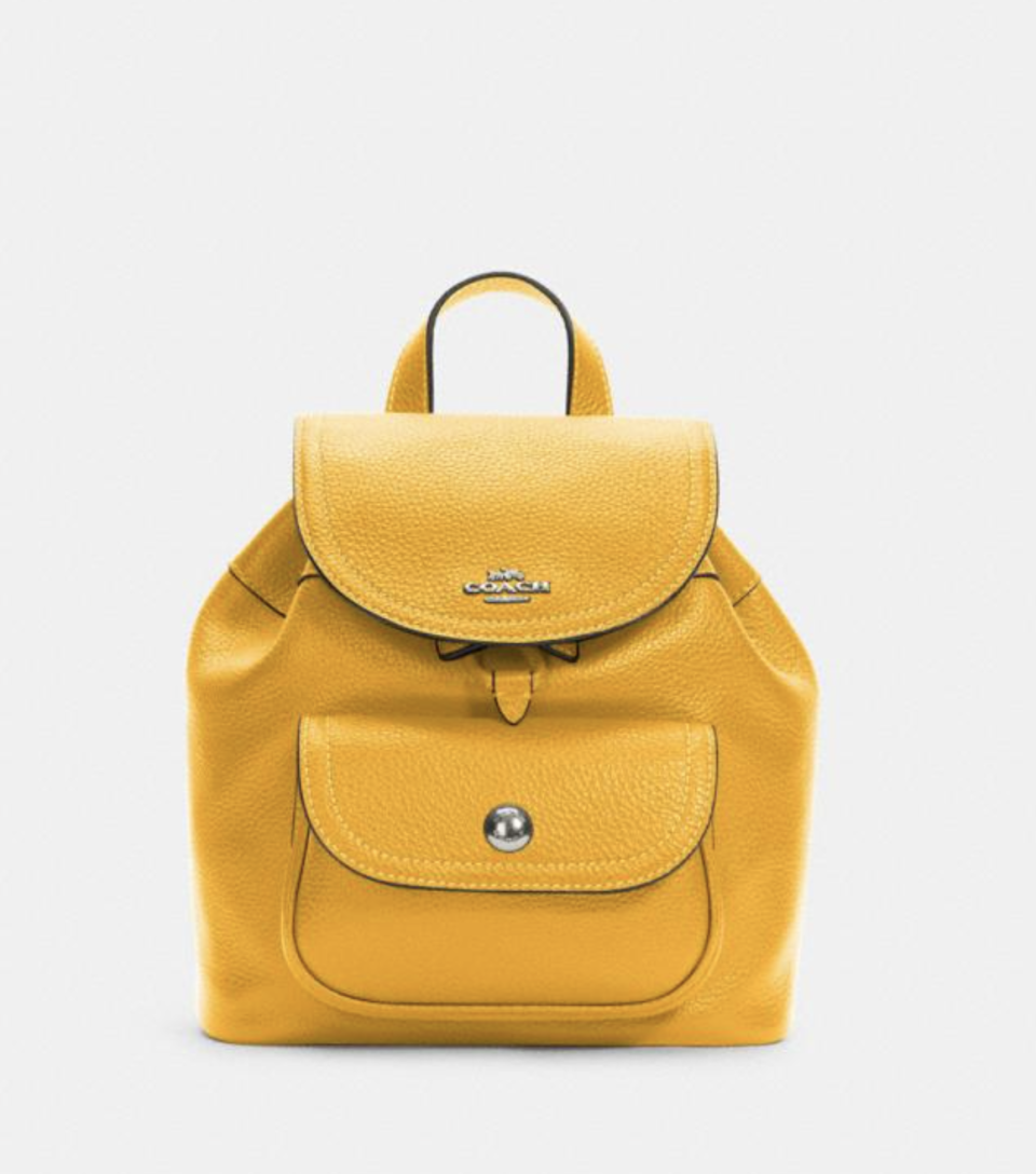 Pennie Backpack 22 in Ochre (Photo via Coach Outlet)