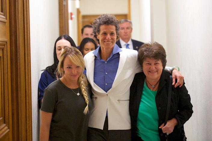 Bill Cosby accuser Andrea Constand (C) reacts with lawyer Dolores Troiani (R) and Delaney Henderson (L) after the guilty on all counts verdict was delivered in the sexual assault retrial at the Montgomery County Courthouse on April 26, 2018 in Norristown, Pennsylvania (Getty Images)