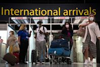 <p>Passengers arrive at Gatwick Airport ahead of Tuesday morning's deadline</p> (PA)