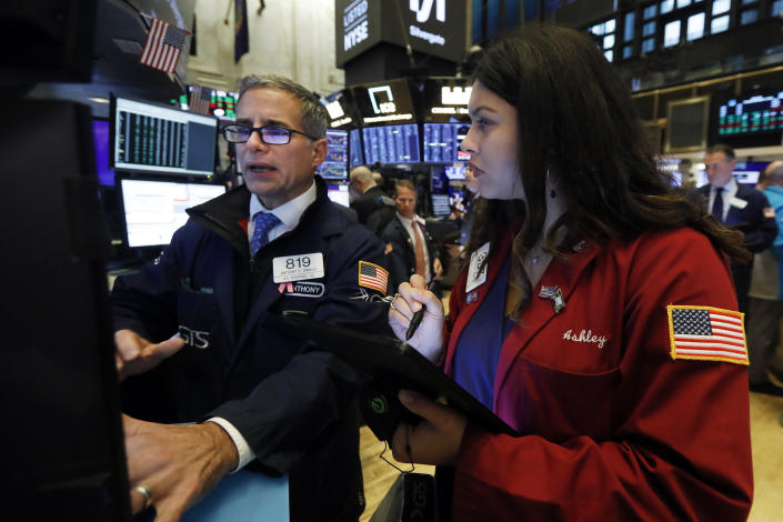 Specialist Anthony Rinaldi, left, and trader Ashley Lara work on the floor of the New York Stock Exchange, Thursday, Nov. 7, 2019. (AP Photo/Richard Drew)