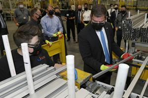 United States Secretary of Labor Marty Walsh tours First Solar's factory in Lake Township, Ohio.