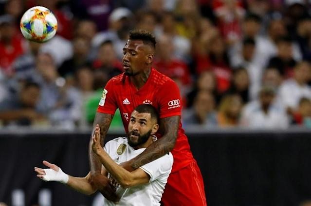 Real Madrid forward Karim Benzema (L) and Bayern Munich defender Jerome Boateng fight for the ball during Bayern's 3-1 friendly victory in Houston, Texas (AFP Photo/AARON M. SPRECHER)
