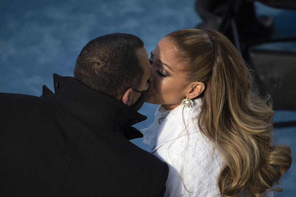 Singer Jennifer Lopez and former baseball player Alex Rodriguez share a kiss after she performed at President-elect Joe Biden's inauguration, Wednesday, Jan. 20, 2021, at the U.S. Capitol in Washington. (Caroline Brehman/CQ Roll Call)