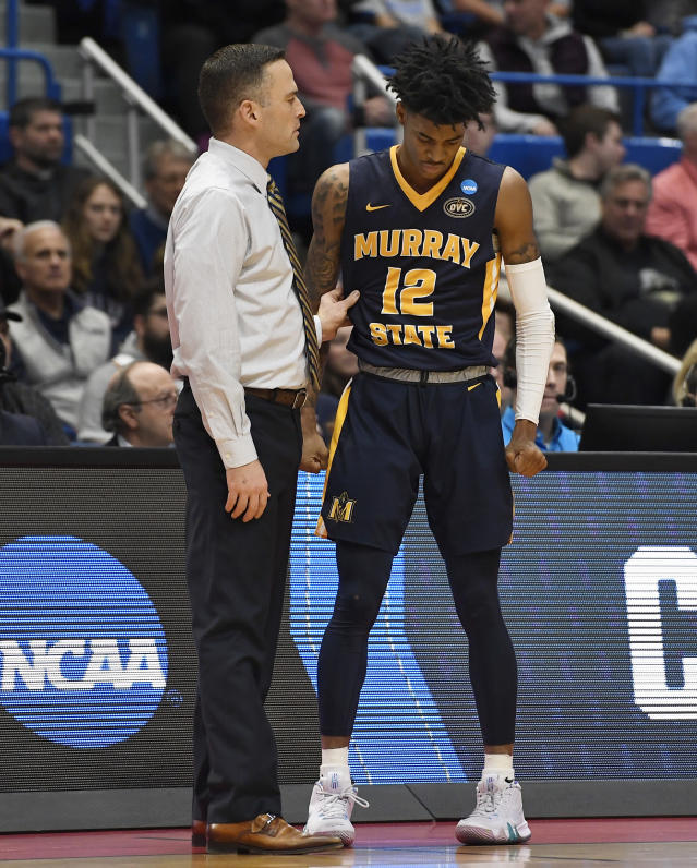 Murray State's head coach Matt McMahon talks with Murray State's Ja Morant (12) during the first half of a second round men's college basketball game against Florida State in the NCAA tournament, Saturday, March 23, 2019, in Hartford, Conn. (AP Photo/Jessica Hill)