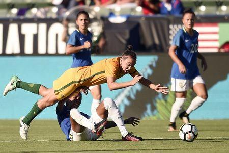 Aug 3, 2017; Carson, CA, USA; Australia midfielder Caitlin Foord (9) and Brazil defender Bruna Benites (3) battle for the ball during the second half at StubHub Center. Australia won 6-1. Mandatory Credit: Kelvin Kuo-USA TODAY Sports