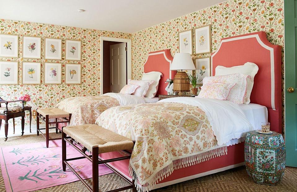 """<p>The <a href=""""https://fave.co/2L600ze"""" rel=""""nofollow noopener"""" target=""""_blank"""" data-ylk=""""slk:Quadrille"""" class=""""link rapid-noclick-resp"""">Quadrille</a> wallcovering and bed cover fabric in the guest room designed by Mark D. Sikes awakens the historic charm this 1950s home. The rugs are by <a href=""""https://fave.co/2i0TLdl"""" rel=""""nofollow noopener"""" target=""""_blank"""" data-ylk=""""slk:Merida"""" class=""""link rapid-noclick-resp"""">Merida</a> (natural) and <a href=""""https://www.madelineweinrib.com/"""" rel=""""nofollow noopener"""" target=""""_blank"""" data-ylk=""""slk:Madeline Weinrib"""" class=""""link rapid-noclick-resp"""">Madeline Weinrib</a> (pink cotton). The door is painted Calke Green by <a href=""""https://fave.co/2DykFFX"""" rel=""""nofollow noopener"""" target=""""_blank"""" data-ylk=""""slk:Farrow & Ball"""" class=""""link rapid-noclick-resp"""">Farrow & Ball</a>.</p>"""