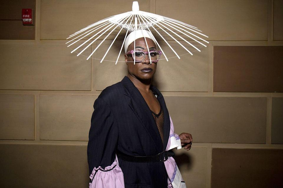 <p>Walking through Gotham Hall in New York City, Porter stunned in a custom up-cycled jacket with lavender-hued cuffs by Fountain Head NYC, trousers by Frank de Bouge and a white hat by Heidilee.</p>