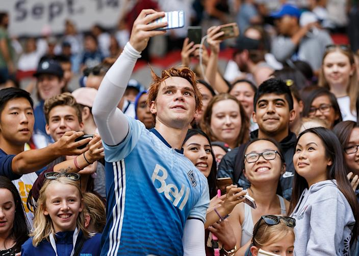 Actor KJ Apa takes a selfie with fans after the Legends And Stars: Whitecaps FC Charity Alumni match at BC Place on September 16, 2017 in Vancouver, Canada.